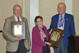 Nick Geacintov and Suse Broyde receiving the Founders' Award from Paul Hollenberg